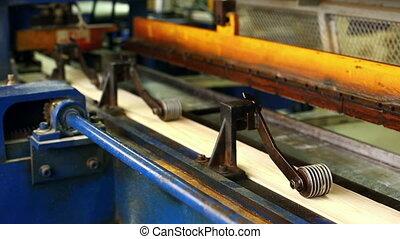 Glulam production. View of slats on conveyor
