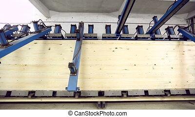 Glulam under pressure turns into edge-glued panel - Glued...