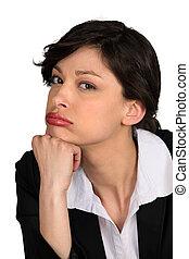 Glum looking businesswoman