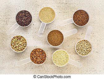 gluten free grains in measuring scoops on wood