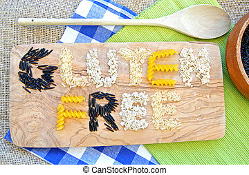 Gluten free grains including rice based pasta and oats over a chopping board