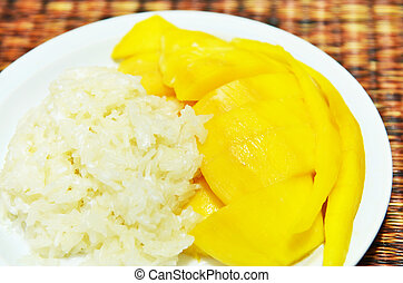glutinous rice eat with mangoes - Thai style tropical...