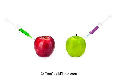 GMO concept - Two GMO apples with syringes on the white