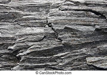 Metamorphic rock background - gneiss texture in New Zealand