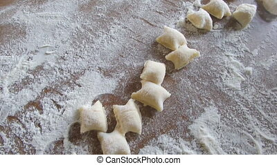 Gnocchi In Flour - Potato gnocchi in flour on wood table.