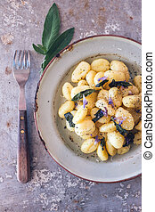 Gnocchi in sage butter with sage flowers
