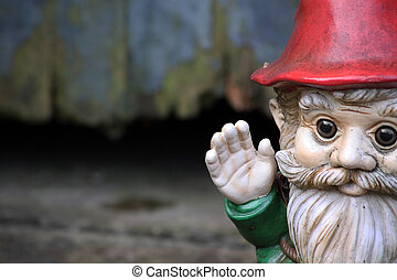 Gnome - A bearded garden gnome on a landscape format set to...