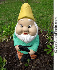 Gnome - Close up of a watchful ceramic garden gnome. (We...
