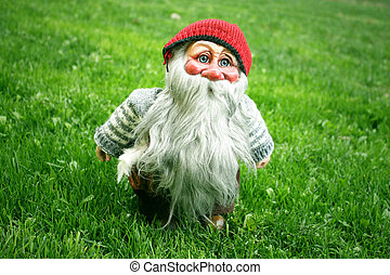Gnome standing on the grass - Photo of a beautiful gnome...