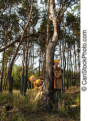 Gnomes in the forest - Children wearing yellow caps in...