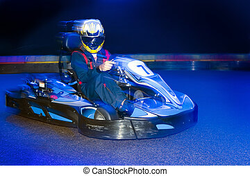 Go-Cart driver - Go-cart driver during a lap on an indoor ...