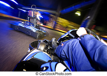 Go-cart in pursuit - Go-carts in pursuit on an indoor race...