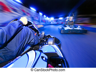Go-Cart Race - Two go-carts racing close to eachother on an...