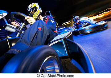 Go-Cart Race - Two go-cart drivers batteling in a...