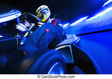 Go-Carting - Go-Cart racing driver taking the apex on an...