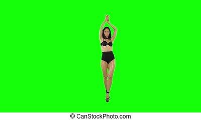 Go-go dancer girl isolated on green screen. Slow motion.