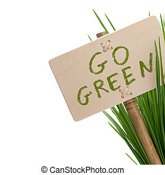 go green message on a wooden panel and green plant - image...