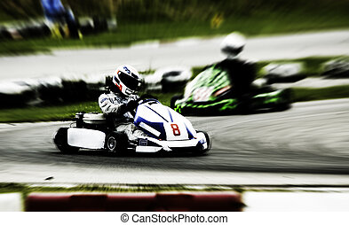 go kart racing on circuit (Blurry!)