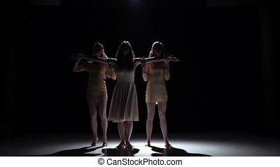 Go on contemporary dance of three girls in white dresses, on black, shadow, slow motion