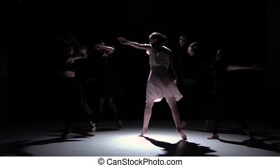 Go on contemporary dance performance of five dancers on black, shadow, slow motion