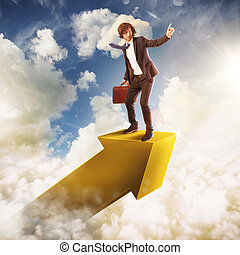 Go over to success - Man on an arrow in the sky