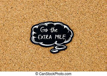 Go The Extra Mile written on black thinking bubble