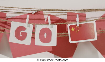 Go word collected by child hand from paper cards with red...