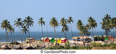 Goa beach - Colorful huts on beach in Goa