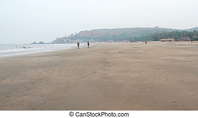 Unidentified man running on the beach. - Goa, India -...