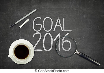 Goal 2016 concept on black blackboard with empty paper sheet