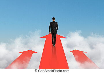 goal concept, businessman on arrow