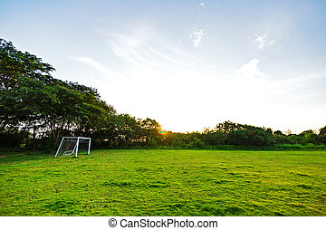 goal football in the park with a sunlight.