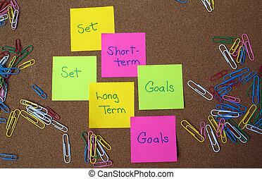 Goal setting - Set long term and short term goals written on...