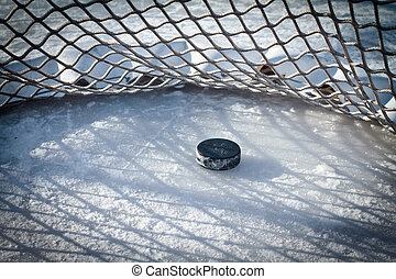 Goal - Hockey net with puck in goal