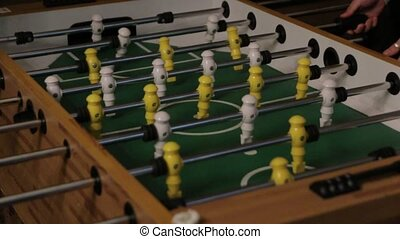 Goal Table Football - Two men playing table football yellow...