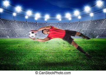Goalkeeper catches the ball . At the stadium,