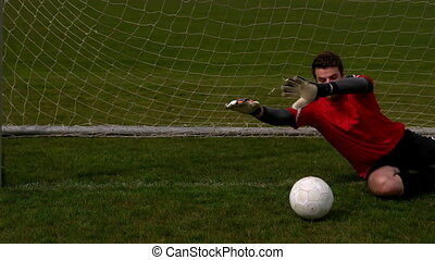Goalkeeper in red letting in a goal