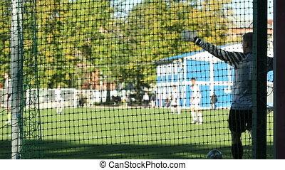 Goalkeeper kicks the ball away