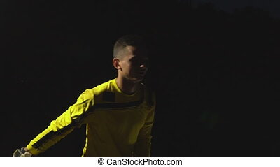 goalkeeper on black background