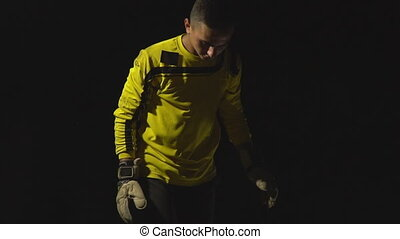 goalkeeper on black background - goalkeeper with the ball on...