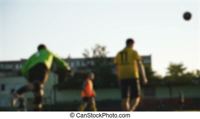 Goalkeeper throws the soccer ball, blurred - goalie throws...