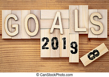 goals 2018 change to 2019 concept. Wooden block cube with...