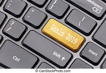 Goals 2019 on golden enter key, of a black keyboard.