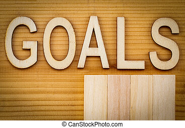 goals banner - text in vintage letters on wooden blocks