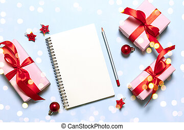 Goals plans dreams make to do list. New year winter holiday xmas concept writing in notebook.