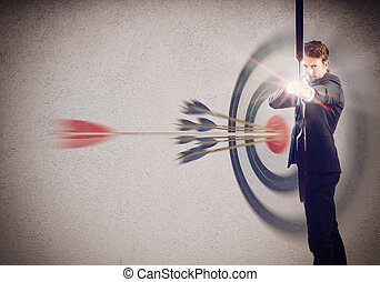 Goals to achieve - Businessman with bow and background with ...