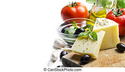 Goat cheese, olives, olive oil, tomato, garlic, basil and spices on wooden cutting board isolated on white background. Food ingredients for italian pizza recipe.