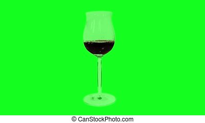 Goblet of red wine fills up on the green screen