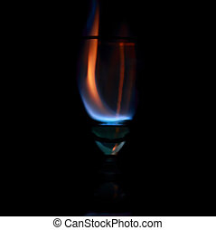 goblet with blaze on black background