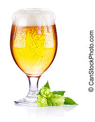 goblet with fresh beer and leaves hop